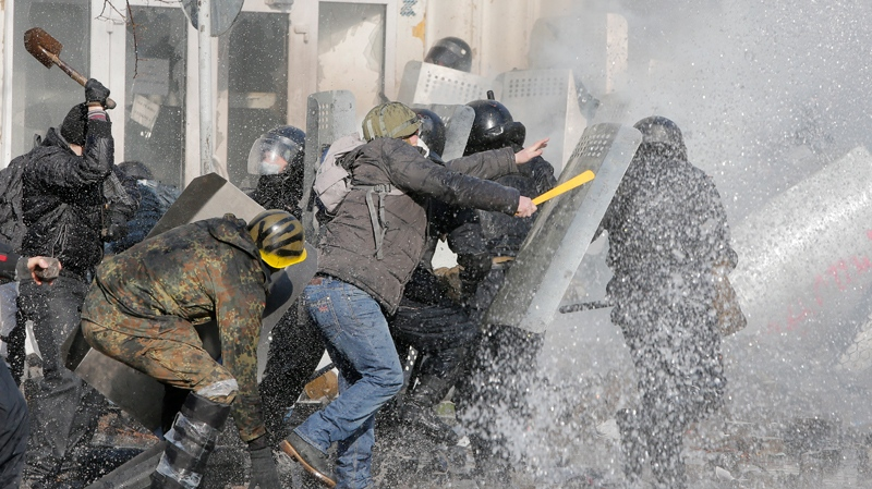Anti-government protesters clash with riot police outside Ukraine's parliament in Kyiv, Ukraine, Tuesday, Feb. 18, 2014. (AP / Efrem Lukatsky)