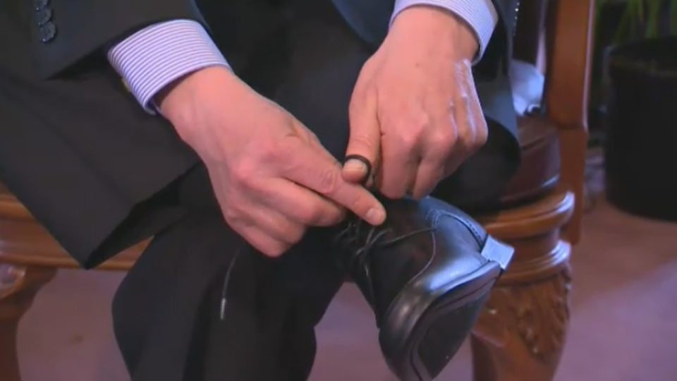 Finance minister Nicolas Marceau shows off his new shoes in advance of Thursday's budget (Feb. 18, 2014)