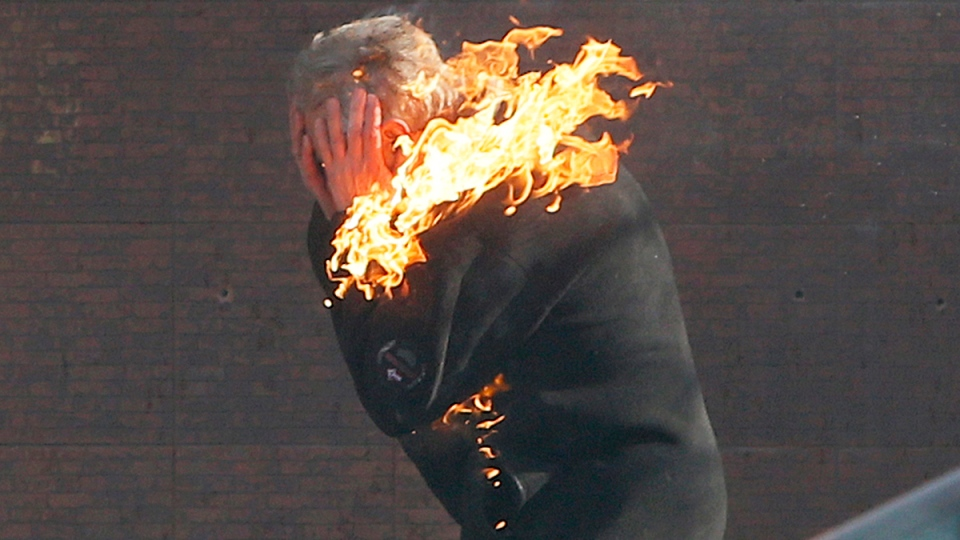 An anti-government protester is engulfed in flames during clashes with riot police outside Ukraine's parliament in Kyiv, Ukraine, Tuesday, Feb. 18, 2014. (AP / Efrem Lukatsky)