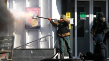 protester fires an improvised weapon in Kyiv