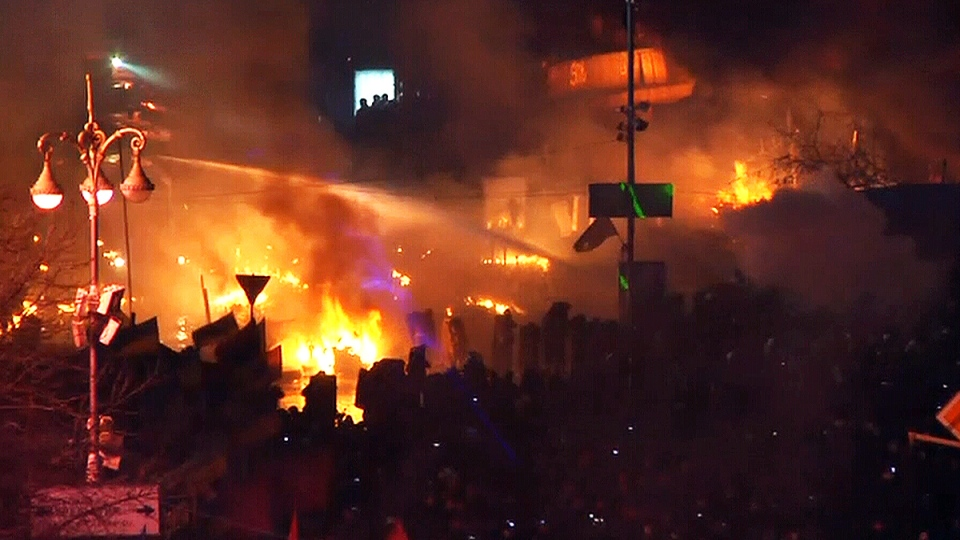 Flames rise during clashes between anti-government protesters and police in Independence Square in Kyiv, Ukraine, Tuesday, Feb. 18, 2014.