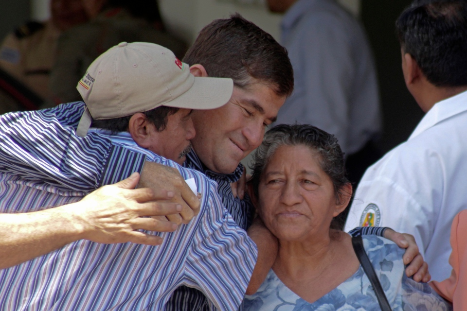 Sea survivor Jose Salvador Alvarenga, centre, is embraced by his parents outside of the hospital where he was being treated for the psychological and physical effects of his journey at sea on Feb. 18, 2014. (AP / Salvador Melendez)
