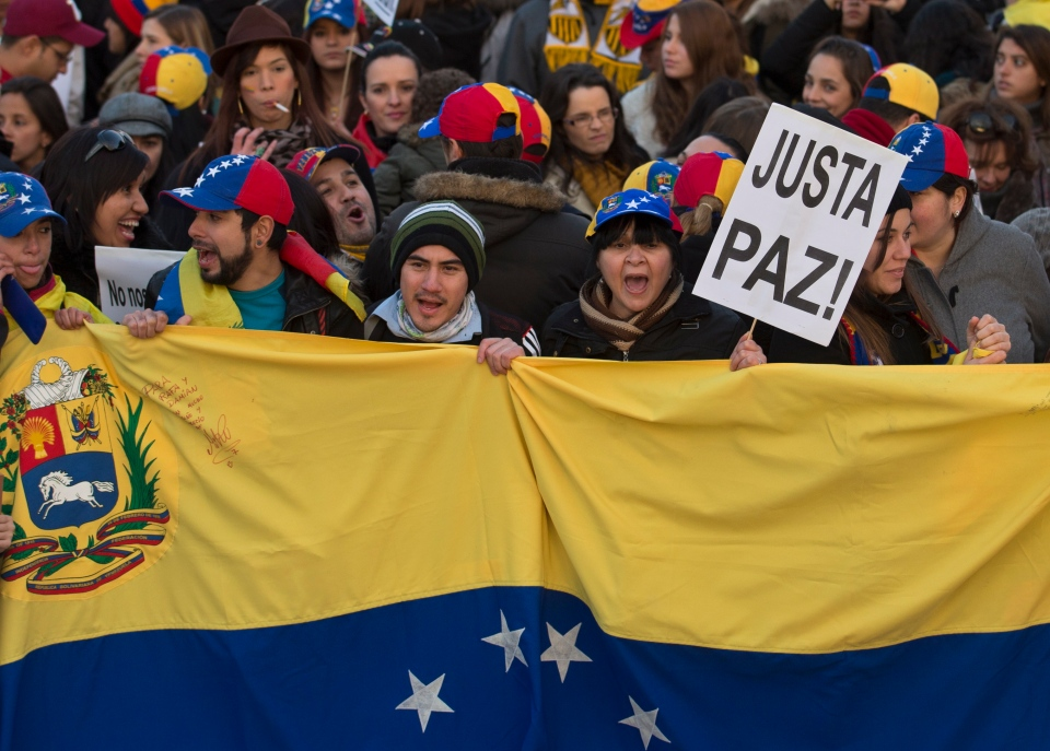 Venezuelans protest against the Venezuelan government in Madrid, Spain, Tuesday, Feb. 18, 2014. (AP Photo/Paul White)