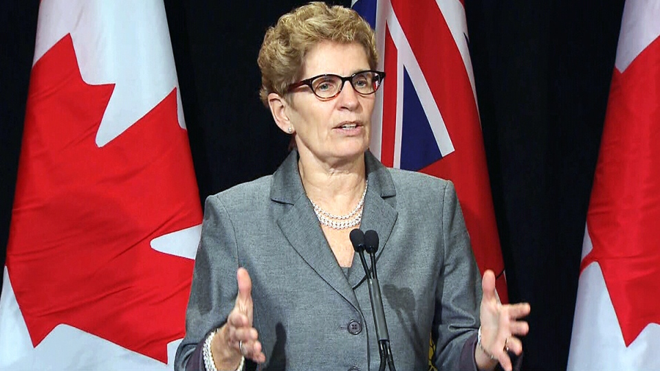 Ontario Premier Kathleen Wynne speaks during a press conference in Toronto, Tuesday, Feb. 18, 2014.