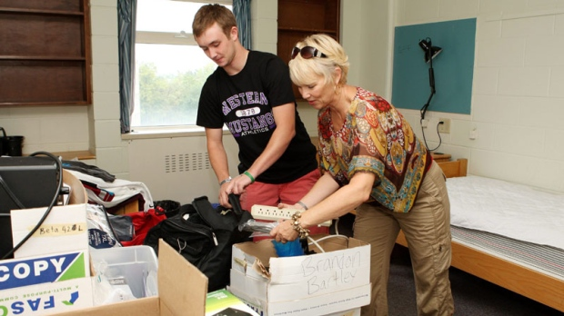 Student Bradon Bartley and his mother, Faye, from New York state, unpack belongings of the first year student as he moves into a residence at The University of Western Ontario in London, Ont., on September 4, 2011. (THE CANADIAN PRESS/Dave Chidley)