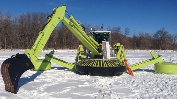 An Amphibex machine works to break up ice near Breezy Point, Man. on Feb. 18, 2014.