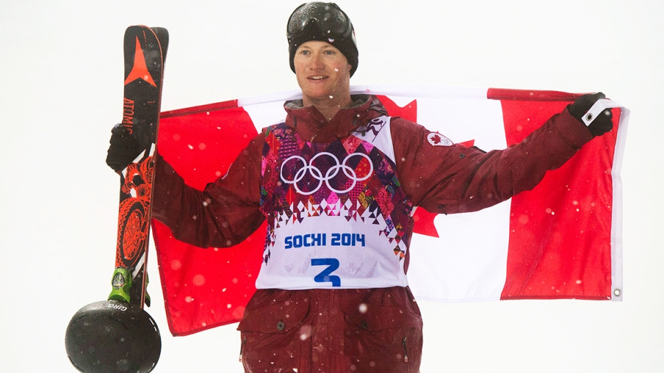 Canada's Mike Riddle celebrates his silver medal win in the Men's Ski Halfpipe final at the Sochi Winter Olympics in Krasnaya Polyana, Russia, Tuesday, Feb. 18, 2014. (Jonathan Hayward / THE CANADIAN PRESS)