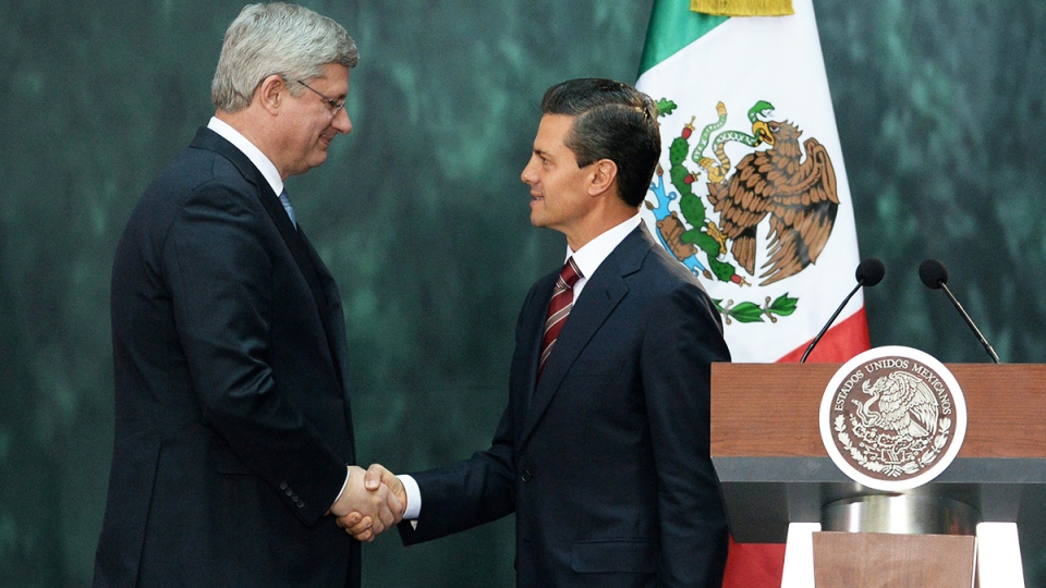 Prime Minister Stephen Harper takes part in a joint press conference with Mexican President Enrique Pena Nieto at the National Palace in Mexico City, Mexico on Tuesday, Feb. 18, 2014. (Sean Kilpatrick / THE CANADIAN PRESS)