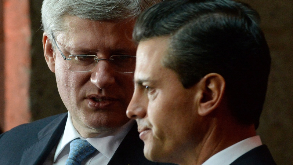 Prime Minister Stephen Harper takes part in a joint press conference with Mexican President Enrique Pena Nieto at the National Palace in Mexico City, Mexico on Tuesday, February 18, 2014. (Sean Kilpatrick / THE CANADIAN PRESS)