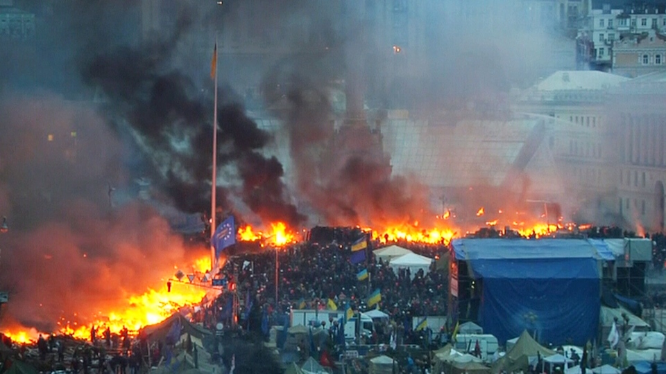 Anti-government protesters clash with riot police in Kyiv's Independence Square in Ukraine, Wednesday, Feb. 19, 2014.