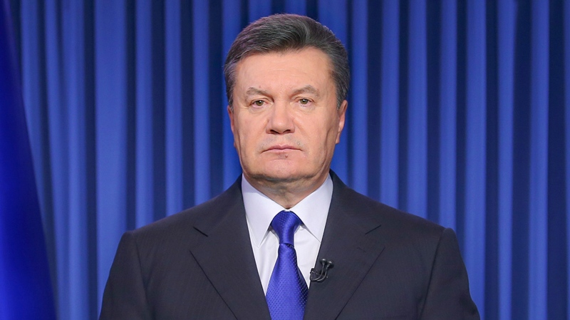 Ukrainian President Viktor Yanukovych addresses the nation on a live TV broadcast in Kyiv, Ukraine, early Wednesday, Feb. 19, 2014. (AP / Andrei Mosienkol)
