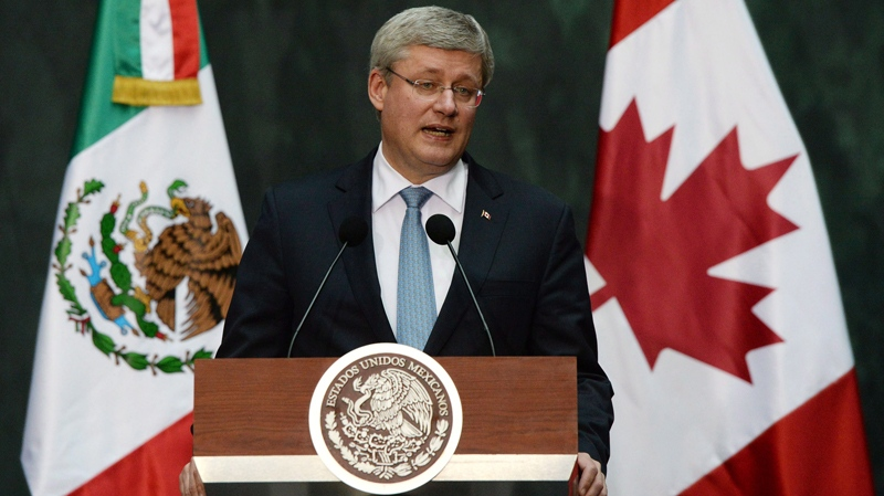 Prime Minister Stephen Harper holds a press conference for Canadian media at the National Palace in Mexico City, Mexico on Tuesday, February 18, 2014. (THE CANADIAN PRESS/Sean Kilpatrick)
