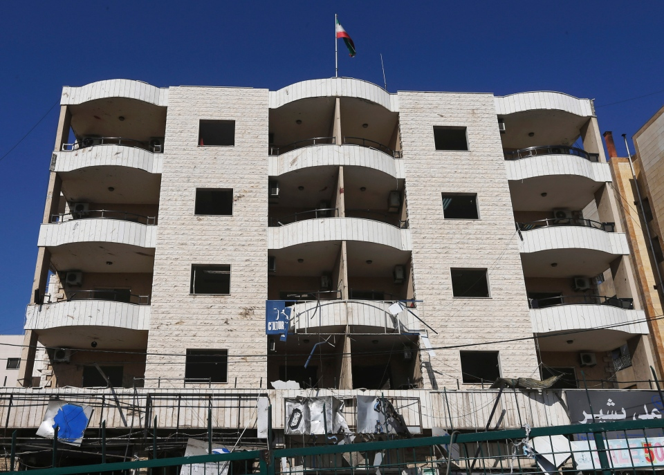 The Iranian flag is seen on the top of the Iranian cultural center building in the suburb of Beir Hassan, Beirut, Lebanon, Wednesday, Feb. 19, 2014. A blast in a Shiite district in southern Beirut killed at least two people on Wednesday, security officials said — the latest apparent attack linked to the civil war in neighboring Syria. (AP Photo/Hussein Malla)
