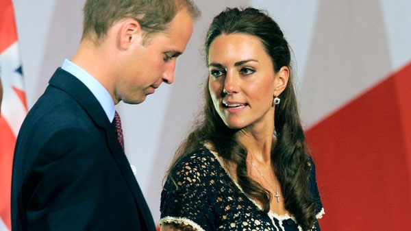 Prince William and Kate, the Duke and Duchess of Cambridge, leave the stage after his remarks at the Service Nation: Mission Serve 'Hiring Our Heroes Los Angeles' job fair event at Sony Pictures Studios in Culver City, Calif., Sunday, July 10, 2011. (AP / Chris Pizzello)