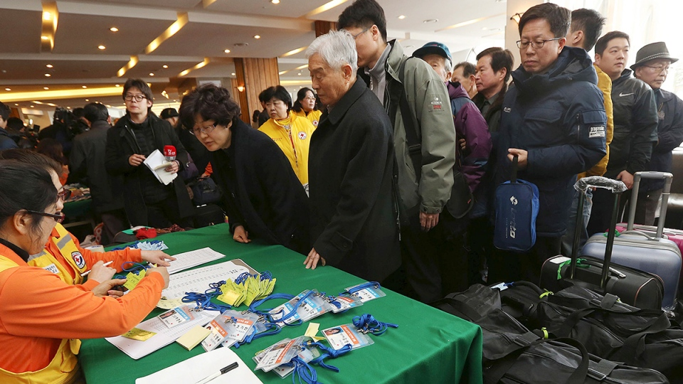 Elderly people arrive for a hotel to take part in the reunions with their family members in North Korea, in Sokcho, South Korea, Wednesday, Feb. 19, 2014. (AP / Yonhap, Lee Ji-eun)