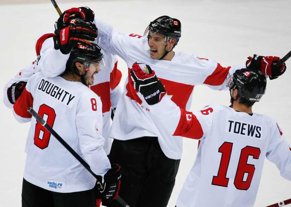 Team Canada celebrates a third period goal against Latvia during a men's quarterfinal ice hockey game at the 2014 Winter Olympics,  in Sochi, Russia, Wednesday, Feb. 19, 2014. (AP / Mark Humphrey)