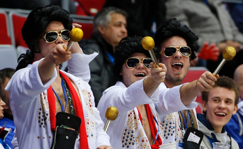 Hockey fans dressed as Elvis entertain other fans during a break in play during the third period of a men's quarterfinal game between Canada and Latvia at the 2014 Winter Olympics, Wednesday, Feb. 19, 2014, in Sochi, Russia. (AP / Julio Cortez)