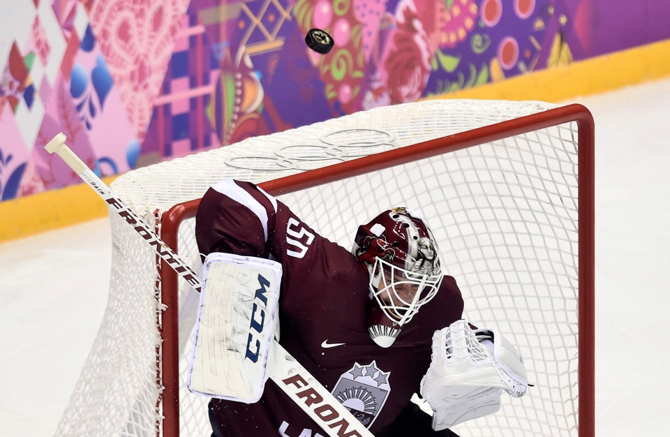 Latvia goalie Kristers Gudlevskis makes a save against Canada during second period quarter-final hockey action at the 2014 Winter Games in Sochi, Russia on Feb. 19, 2014. (Nathan Denette/THE CANADIAN PRESS)