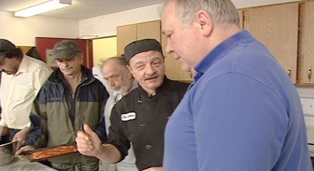 Chef Robert Lahaie teaching men how to cook.