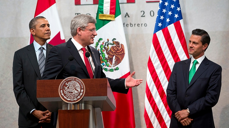 Canadian Prime Minister Stephen Harper, centre, turns to Mexican President Enrique Pena Nieto, right, with U.S. President Barack Obama, while speaking during the seventh trilateral North American Leaders Summit Meeting in Toluca, Mexico Wednesday Feb. 19, 2014. (AP / Jacquelyn Martin)