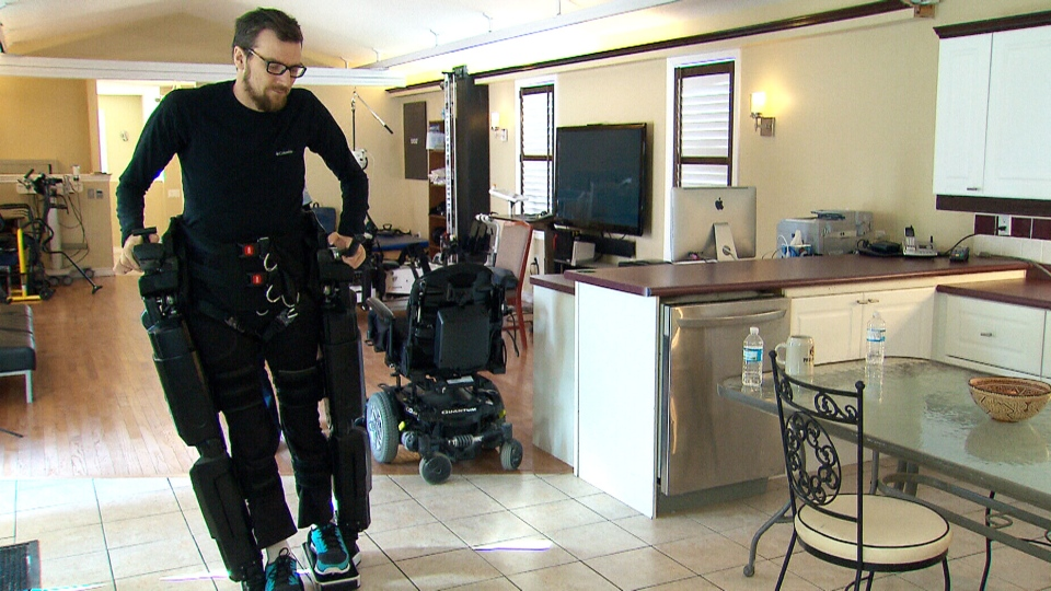 Mitch Brogan was paralyzed after getting hit  by a drunk driver nearly eight years ago. He's able to walk due to technology called exoskeletons.