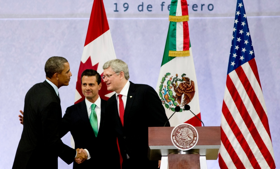 President Barack Obama, left, Mexico's President Enrique Pena Nieto, center, and the Prime Minister of Canada, Stephen Harper, shake hands at the end of a news conference concluding the North American Leaders Summit in Toluca, Mexico, Wednesday, Feb. 19, 2014. (AP / Eduardo Verdugo)