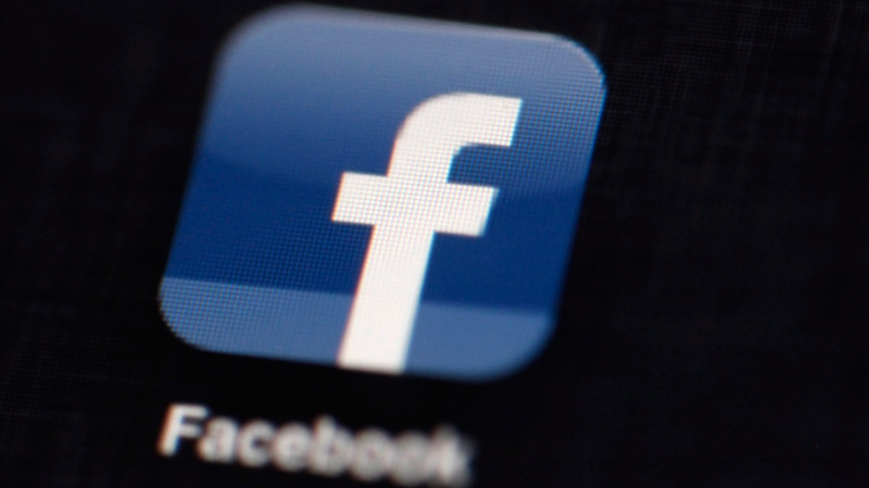 This May 16, 2012 file photo shows the Facebook logo displayed on an iPad in Philadelphia. (AP Photo/Matt Rourke, File)