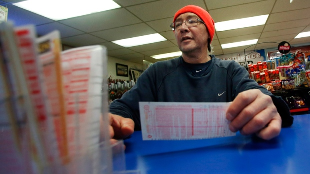 Buting a Powerball lottery ticket in Mass.