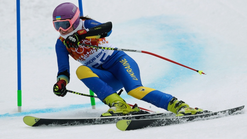 Ukraine's Bogdana Matsotska passes a gate in the women's super-G at the Sochi 2014 Winter Olympics in Krasnaya Polyana, Russia, Saturday, Feb. 15, 2014. (AP / Charles Krupa)