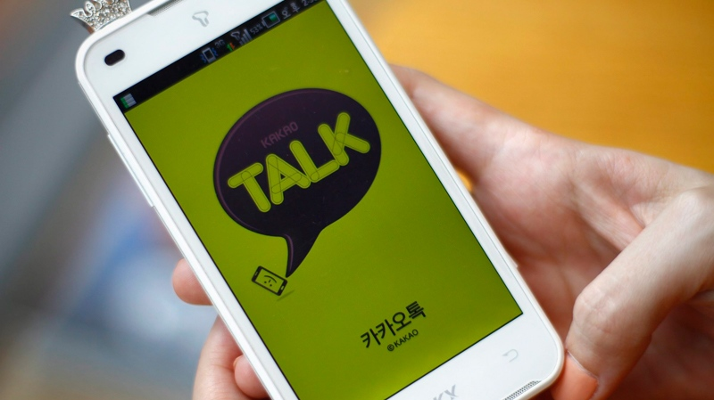 In this Aug. 20, 2012 photo, a woman opens Kakao Talk, a South Korean mobile messaging app with more than 60 million users, on her smartphone in Seoul, South Korea. (AP Photo/Hye Soo Nah)