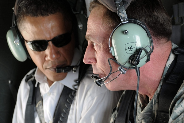 U.S. presidential candidate Barack Obama, left, and top U.S. military commander in Iraq, David Petraeus, talk as they take a helicopter ride over Baghdad, Iraq, Monday, July 21, 2008. (AP / Ssg. Lorie Jewell)