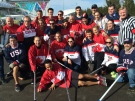 Members of the Canadian and American unofficial street hockey teams pose for a group photo in Sochi. (Peter Akman/CTV News)
