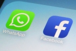 This Wednesday, Feb. 19, 2014 photo shows the WhatsApp and Facebook app icons on an iPhone in New York. (AP / Patrick Sison)