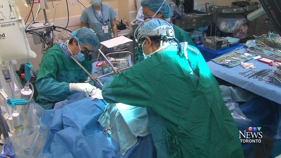 Surgeons perform a heart bypass procedure at Sunnybrook hospital in Toronto on Thursday, Feb. 20, 2014.
