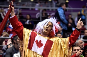 Team Canada fans and supporters have descended on Sochi, Russia, donning their best red and white to cheer on the athletes as they compete for gold in the Winter Games.<br><br>Canada fans ham it up prior to gold medal final hockey action at the Sochi Winter Olympics in Sochi, Russia, Thursday, February 20, 2014. (Paul Chiasson / THE CANADIAN PRESS)