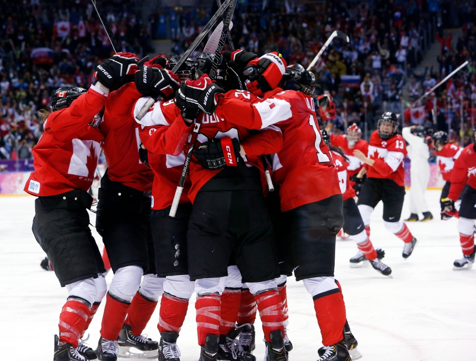 Team Canada celebrates after scoring in overtime to beat the U.S.A. in the women's gold medal ice hockey game at the 2014 Winter Olympics, Thursday, Feb. 20, 2014, in Sochi, Russia. (AP / Mark Humphrey)
