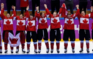 Members of Team Canada celebrate during the medal ceremony after the women's ice hockey tournament at the 2014 Winter Olympics in Sochi, Russia, Thursday, Feb. 20, 2014. (AP / Petr David Josek)