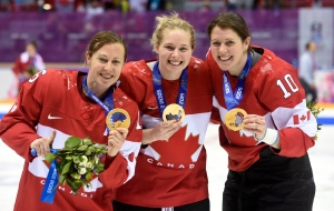 Team Canada's Jayna Hefford (left to right) Haley Irwin and Gillian Apps show off their gold medals after defeating Team U.S.A. in the women's gold medal hockey game at the Sochi Winter Olympics in Sochi, Russia, Friday, February 21, 2014. (Paul Chiasson / THE CANADIAN PRESS)
