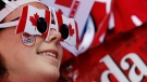 A Canadian fan watches the start of the women's gold medal ice hockey game between Canada and the United States at the 2014 Winter Olympics in Sochi, Russia, Thursday, Feb. 20, 2014. (AP / Julio Cortez)