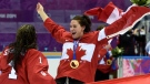 Canada 's Natalie Spooner (right) celebrates with goalie Shannon Szabados after winning the women's gold medal hockey game at the Sochi Winter Olympics in Sochi, Russia, Friday, February 21, 2014. (Paul Chiasson / THE CANADIAN PRESS)