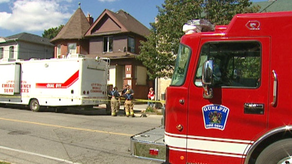 Firefighters are seen at the scene of a fire at a rooming house in Guelph, Ont. on Sunday, Sept. 18, 2011.