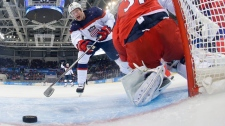 Zach Parise scores on Ondrej Pavelec in Sochi