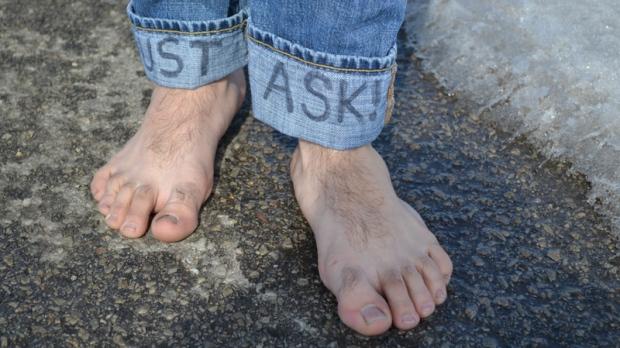 Man Wear Shoes In One Foot