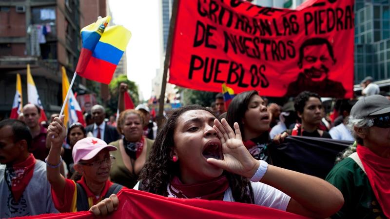 Members of a pro-government 'colectivo,' or 'collective,' march in downtown Caracas, Venezuela, Thursday, Feb. 20, 2014. (AP Photo/Rodrigo Abd)