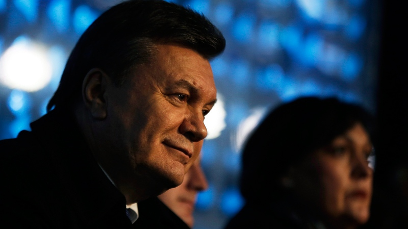 Ukrainian President Viktor Yanukovych watches the opening ceremony of the 2014 Winter Olympics in Sochi, Russia, Friday, Feb. 7, 2014. (AP / David Goldman)