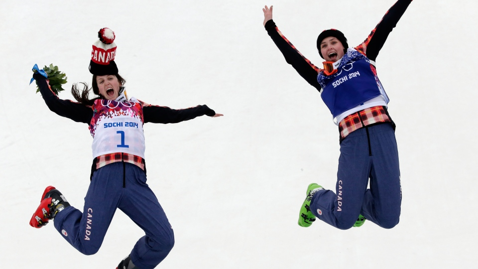 Gold medallist Marielle Thompson of Canada, right, celebrates on the podium with silver medalist and compatriot Kelsey Serwa, left, at the Rosa Khutor Extreme Park, at the 2014 Winter Olympics, Friday, Feb. 21, 2014, in Krasnaya Polyana, Russia. (AP / Andy Wong)
