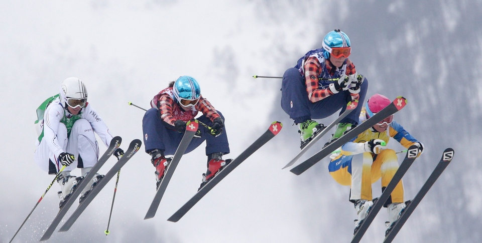 From left: France's Ophelie David, from left, Canada's Kelsey Serwa, Canada's Marielle Thompson and Sweden's Anna Holmlund compete during their ski cross final at the 2014 Winter Olympics, Friday, Feb. 21, 2014, in Krasnaya Polyana, Russia. (AP / Matthias Schrader)
