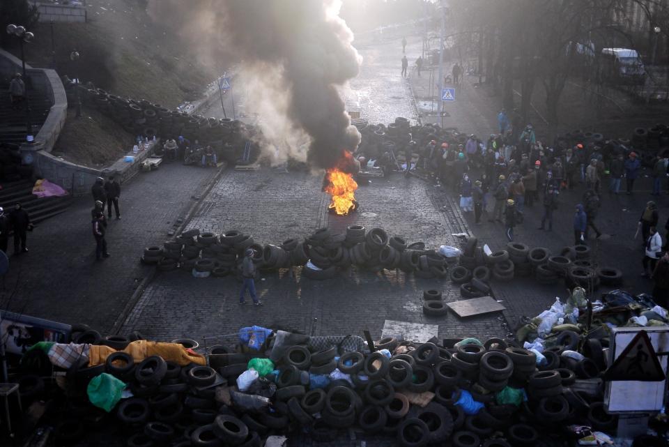 A fire burns at the barricades on the outskirts of Independence Square in Kiev, Ukraine, Friday, Feb. 21, 2014. (AP / Marko Drobnjakovic)