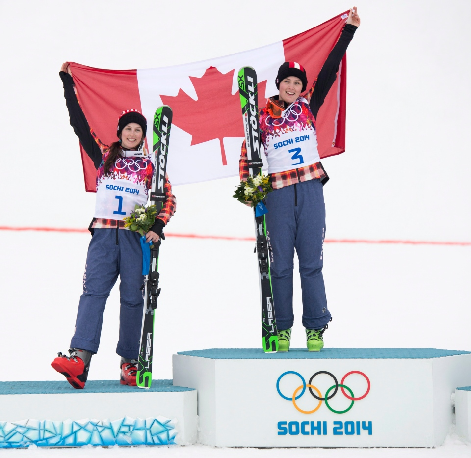 Canada's silver medallist Kelsey Serwa, left to right, and gold medalist Marielle Thompson celebrate their win following the Ladies Ski Cross final at the Sochi Winter Olympics in Krasnaya Polyana, Russia, Friday, Feb. 21, 2014. (Jonathan Hayward / THE CANADIAN PRESS)