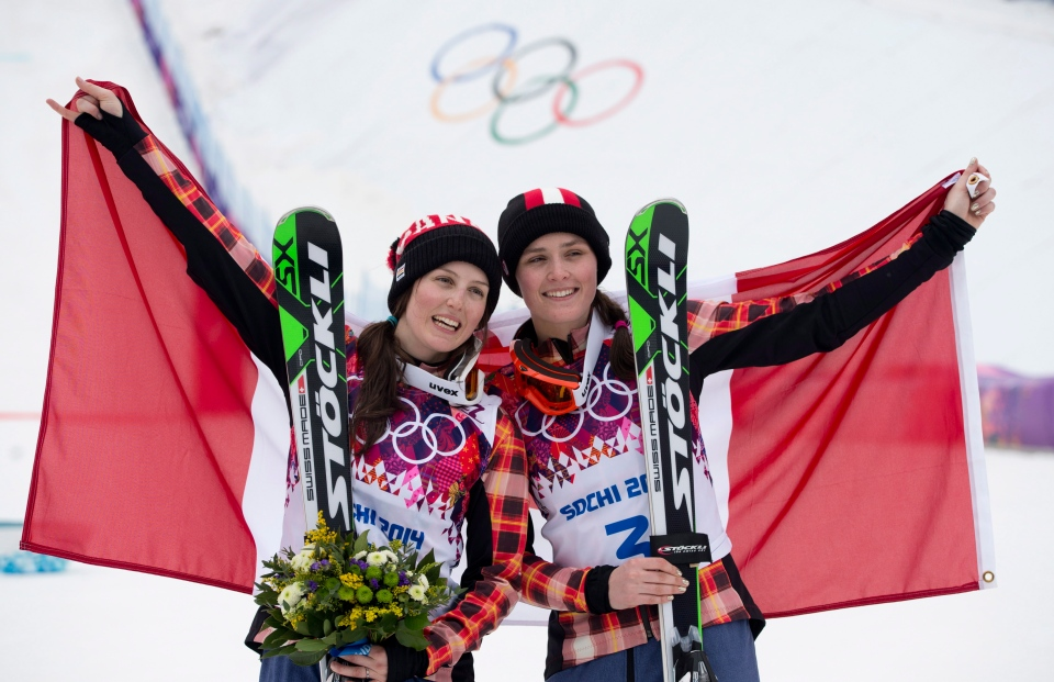 Canada's silver medallist Kelsey Serwa, left to right, and gold medallist Marielle Thompson celebrate their win following the Ladies Ski Cross final at the Sochi Winter Olympics in Krasnaya Polyana, Russia, Friday, Feb. 21, 2014. (Jonathan Hayward / THE CANADIAN PRESS)
